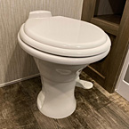 Porcelain Stool w/ Water Jet Assist May Show Optional Features. Features and Options Subject to Change Without Notice.