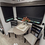 Dine in comfort with a full view of your campsite.  Each Champagne Edition unit comes with a dining table with leaf extension and 4 freestanding chairs (2 solid, 2 folding).  The serving credenza houses the outside 32' television. May Show Optional Features. Features and Options Subject to Change Without Notice.