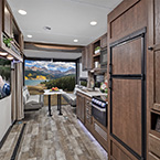 "Our 2217 gives you one of the largest garage lengths in the industry and is just over 26' total length! A large 39"" TV, spacious overhead storage, and 25% more countertop space make this a great model. May Show Optional Features. Features and Options Subject to Change Without Notice."