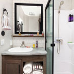 The 40FDEN bathroom provides a LARGE walk-in shower, sink with linen storage below, and modern mirror medicine cabinet May Show Optional Features. Features and Options Subject to Change Without Notice.