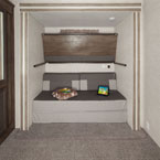 The 42QBQ bunk room features an easy flip-up bunk and the Versa-Queen May Show Optional Features. Features and Options Subject to Change Without Notice.