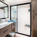 The 42DL bathroom features TONS of linen storage and a residential walk-in shower May Show Optional Features. Features and Options Subject to Change Without Notice.