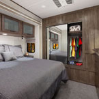 The 42QBQ bedroom features the Serta Mattress, overhead storage, dresser, panoramic windows, and modern mirror door closet May Show Optional Features. Features and Options Subject to Change Without Notice.