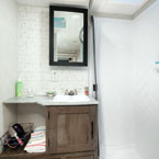 The 31KQBTS bathroom offers a walk-in shower and modern mirror medicine cabinet. May Show Optional Features. Features and Options Subject to Change Without Notice.