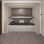 "Pictured is the Versa-Queen with the above bunk in the ""up"" position. May Show Optional Features. Features and Options Subject to Change Without Notice."