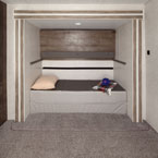 "Versa-Queen in its bunk option with the above bunk in the ""up"" position. May Show Optional Features. Features and Options Subject to Change Without Notice."