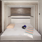 Versa-Queen in its queen bed form with the bunk above up. May Show Optional Features. Features and Options Subject to Change Without Notice.