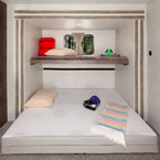 Versa-Queen in its queen bed form with the bunk above down. May Show Optional Features. Features and Options Subject to Change Without Notice.