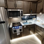 The 353FLFB kitchen features stainless steel kitchen appliances, an XL window, 1.6 CU FT Whirlpool Microwave, and TONS of storage May Show Optional Features. Features and Options Subject to Change Without Notice.