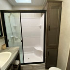 The 353FLFB bathroom includes a LARGE walk-in shower making it feel just like home May Show Optional Features. Features and Options Subject to Change Without Notice.