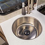 Deep Stainless Steel Sink May Show Optional Features. Features and Options Subject to Change Without Notice.