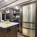 Kitchen with large refrigerator May Show Optional Features. Features and Options Subject to Change Without Notice.