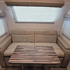 Rear Lounge with Table May Show Optional Features. Features and Options Subject to Change Without Notice.